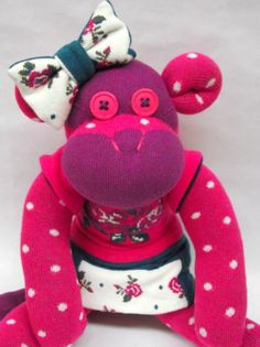 Polka-dotted sock monkey.