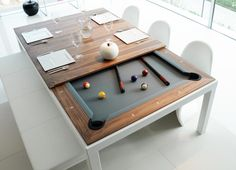 FUSION TABLES: a dining table and pool table all in one. Remove the multi-piece dining top to unveil a beautiful pool table with a contemporary sleek design offering nice wooden and lacquered finishings.