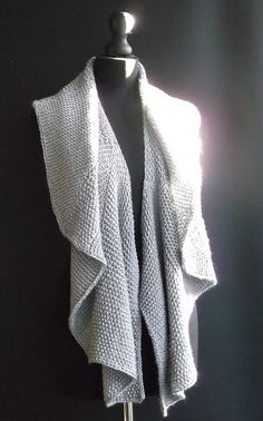 "Cascade's ""Pacific"" is used to knit this garment. Seed stitch panels and garter stitch short rows create a beautiful drape in this scarf. It can be worn in several ways. Open it out and wear as a shawl, or wrap it around your neck for a cosy scarf."