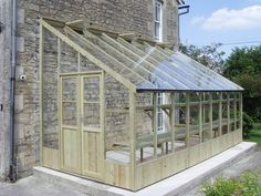 Heron 8x20 lean to greenhouse How about hanging this on to the end of the garage?
