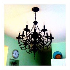 Take an old chandelier, attach strands of Mardi Gras beads, and then spray paint. Easy and brilliant.