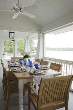 No. 1 screened porch - screened door; wide openings; solid columns and railings; trompe l'oeil rug on floor; furniture; ceiling fan; ceiling beadboard