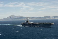 MEDITERRANEAN SEA (April 8, 2014) The aircraft carrier USS Harry S. Truman (CVN 75) transits the Strait of Gibraltar. Harry S. Truman, flagship of Harry S. Truman Carrier Strike Group, is operating in the U.S. 6th Fleet area of responsibility in support of maritime security operations and theater security cooperation efforts. the aircraft carrier is completing a 9-month deployment to the U.S. 6th and 5th Fleet areas of responsibility . (U.S. Navy photo by Mass Comm Spec 3rd Class Laura…