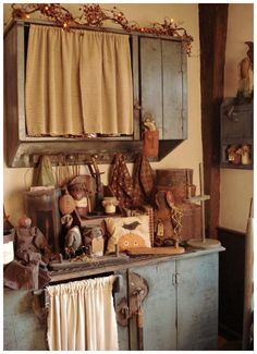 Prim Cupboards...with prim fall needfuls...love the curtains & distressed paint!!