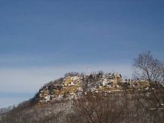 Grandad's Bluff, La Crosse, Wisconsin. I can see this from an upstairs window.  Local landmark, vantage point, my unofficial weather station (the flag tells me about the wind).