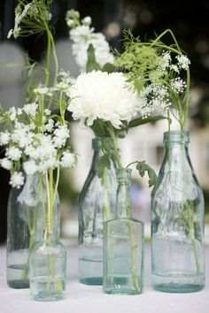 Blue #antique bottles #wedding centerpiece with white flowers | Anna Kerns Photography