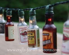 Beer Bottle patio party lights ... the perfect DIY solution for backyard parties or maybe even a Father's Day gift! How many beer bottles do you have? PartyLights.com has mini string lights in many lengths and colors. Shop online at http://www.partylights.com/Mini-Lights.