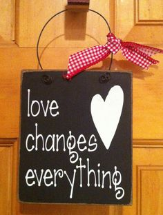 Love changes everything wire hanger