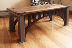 This is one of our custom made coffee tables. This table was inspired by an old industrial bridge here in northern New Jersey. It features a locally recycled wood top and a heavy duty steel base with a powder coated finish.