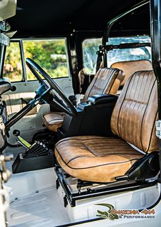 Super clean interior in this Land Cruiser restoration with marine vinyl and automatic conversion shifters detail.