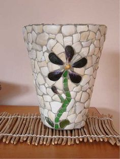 We've all seen those beautiful mosaic pots at garden centers, craft shows and art shows.  But did you know that they're relatively easy t...
