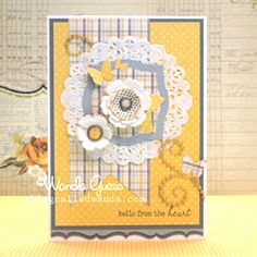 Handmade felt flowers on a shabby chic inspired greeting card. Tried out a new color scheme of yellow, grey and white!
