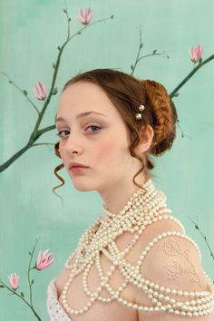 girl with pearls and magnolia Photo by saskia wagenvoort — National Geographic Your Shot