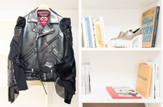 Inside The Closet of Fashion Designer Michelle Elie: Between her Comme des Garçons and Prada archive, incredible decor and art collection, Michelle Elie is one for the books (so we put her in ours). -- Black leather jacket with glitter sleeves.   Coveteur.com