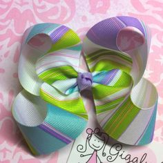 A mutli-colored loopy hair bow! Great with spring colors!!!! Go to Giggly Girl Bowtique on Facebook!