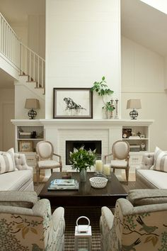 traditional living room by jamesthomas, LLC  Luv the extension of the mantle to create shelving areas.