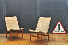Pair Vintage Mathsson Eva Chairs : Modern50 20th Century Vintage Furnishings & Design. SWEDEN, c.1930s. Vintage Mid-Century Modern Bruno Mathsson Eva Armless Easy Chairs. A Rare pair were done for Karl Mathsson and feature steamed birch frames and Original Webbing. All Strong and Useable.  W: 19¼ x D: 25 x Seat H: 17 x Back H: 32 in.