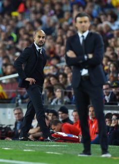 A dejected Josep Guardiola the head coach of Bayern München looks on past Luis Enrique the head coach of Barcelona during the UEFA Champions League Semi Final, first leg match between FC Barcelona and FC Bayern München at Camp Nou on May 6, 2015 in Barcelona, Catalonia.