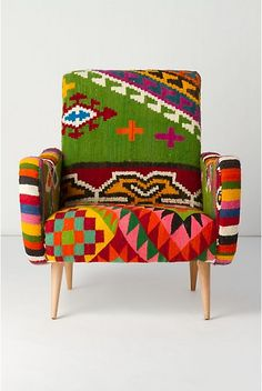 What a great chair! I wonder if it is sold like this, of if you could just bring a snazzy blanket to your upholsterer?