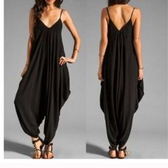 Black Jumper Beautiful fit on this elegant jumper. High quality stretchy polyester. Pants Jumpsuits & Rompers
