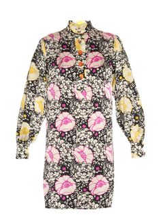 This silk-satin Duro Olowu dress showcases a striking black, white, yellow, and magenta-pink Zanzibar Flower print – an ode to the designer's African heritage. It's cut to a loose silhouette, and detailed with a Mandarin collar and half-button fastening. Pick out the most feminine hue with a tonal accessory.