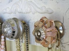 Accessories Rack with Pink, Bronze, and Silver Knobs