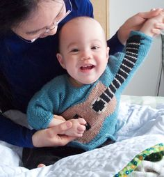 Baby air guitar wrap around sweater pattern. There's nothing new about a wrap-around cardigan with an intarsia guitar design. But if you work the guitar fretboard up a sleeve, suddenly your baby can play air guitar! Knitting For Kids, Sewing For Kids, Knitting Projects, Baby Knitting, Crochet Baby, Crochet Projects, Knit Crochet, Guitar Patterns, Ravelry