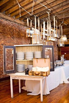 Love the hanging frames & cabinet for plates. Wonder if I could manage that at the Carl House...  Rustic Cotton Warehouse Wedding: Steffany