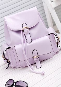 Stuff your gadgets in this faux leather lavender backpack!
