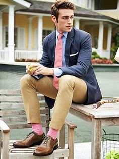 I like the adventurous pink socks and tie combination, bringing some spring freshness to a traditional ensemble.