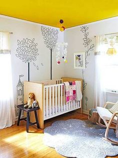 Why isn't a bold yellow paint color the most popular for nurseries? It's certainly the most cheery!  From Best Painted Ceilings Inspiration | Domino