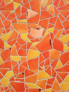 Detail view of Apple Store tile mosaic in Barcelona using colors from the Music iOS app icon