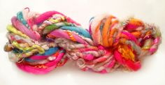 Handspun Art Yarn - Garden of Wooly Delights Mixed Fiber Blend in Neon Happy Birthday Colorway. $28.00, via Etsy.