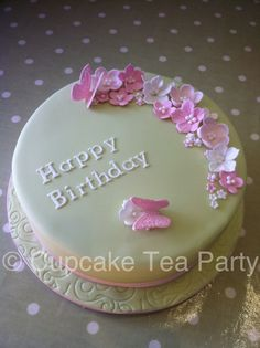 Flowers and butterfly birthday cake. www.cupcaketeaparty.co.uk