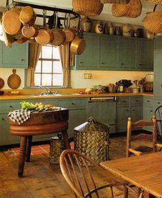 Prim Kitchen...old plank flooring, butcher block, old stoneware jugs above the cabinets & prim baskets!