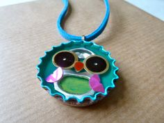 Bottle cap- resin inlay- blue owl -necklace-soda can tab -mixed media-recycle. $24.00, via Etsy.