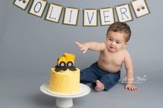 Enjoy an adorable first birthday cake smash with a construction truck theme  for baby Oliver. Photos by Nicole Starr Photography of Saratoga Springs,  NY and Boston, MA.