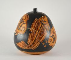 The black background of this stunning gourd is what sets off the beautifully intricate etching of the fish. Artisans in the Andes Mountains of Peru remove the outer skin of gourds (similar to pumpkins