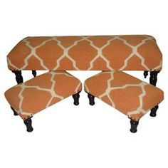 Hardwood-framed bench and two stools with trellis-print jute and wool upholstery.