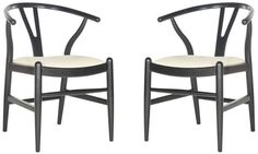 <p>Airy and sculptural, the set of two Aramis dining chairs is inspired by a 20th century classic with new curved seat and apron and comfortable ivory cushion. A curved back and turned legs are crafted of rubber wood in a black finish for enduring beauty.</p>