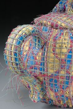 "Donna Marder has three strict rules: Sew only. Paper primarily. Every stitch is done only by her. Following those guidelines for the past 20 years, Marder has taken the old, worn paper bits of her daily life and used her sewing machine, needles, and thread to make ""something out of nothing."""