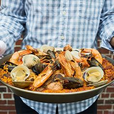 Learn to make our mixed paella over a grill.