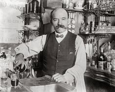 Bartender Pouring Drink 1910. Vintage Photo by HistoryPhoto