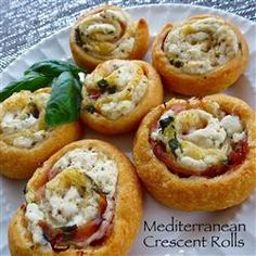 Mediterranean Crescent Pinwheels - will add some chopped sun dried tomatoes to the filling the next time.   Allrecipes.com