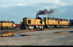 Ooof! That thing is heavy. UP Alco S4 switcher 1181 drags an EMD DD35B around the diesel shop at Kansas City, Kansas July 11, 1965.