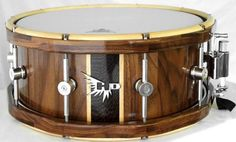 Wow, this is a beautiful walnut snare. Love the color contrast and wood tones in the drum.