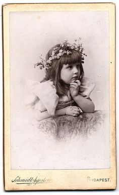 :::::::: Vintage Photograph :::::::::   Sweetness in an antique photo of a little girl with flowers in her hair.