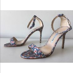 """Shop chycgal's closet or find the perfect look from millions of stylists. Fast shipping and buyer protection. Manolo Blahnik Chaos Floral-Print -Condition: Brand New With Box+ Dust Bag. -Size: EU 40 (Insoles Measure 10 1/4""""). -Color: Floral Print. -Model: Chaos. -Manolo Blahnik floral-print fabric sandal. -Covered heel measures 4"""". -Ankle wrap with adjustable buckle. -Banded open toe. -Leather lining and sole. -""""Chaos"""" is made in Italy. -Retails for $745.00 -Same..."""