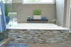 master bathroom remodel with mosaic tile on the front of the bathtub.