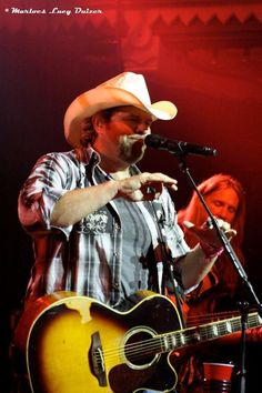 Toby Keith and his bass player Chuck Goff, Jr. - Chuck passed away on February 27, 2013